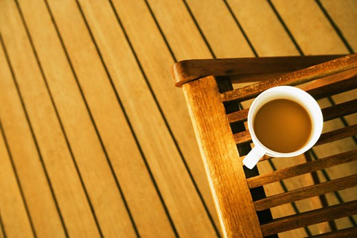Stock Photo: 1741R-6171 High angle view of a cup of tea on a deck chair