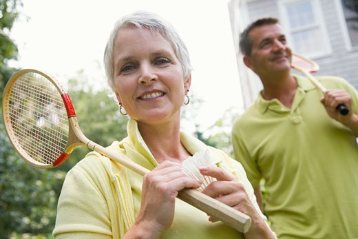 Stock Photo: 1741R-8749 Close-up of a mature woman holding a badminton racket and a shuttlecock