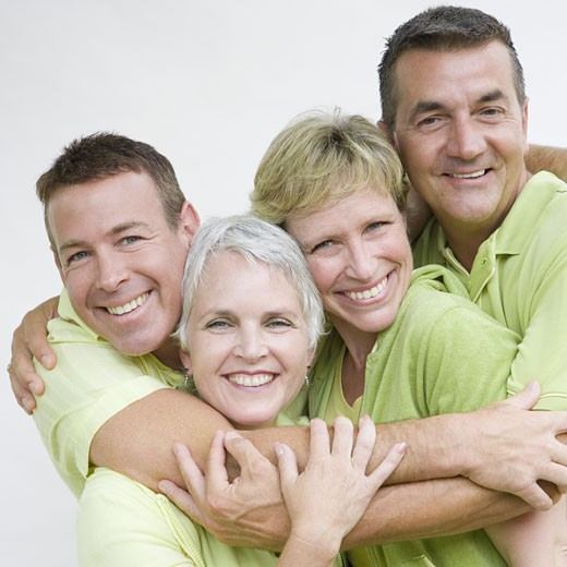 Portrait of two mature couples smiling together : Stock Photo