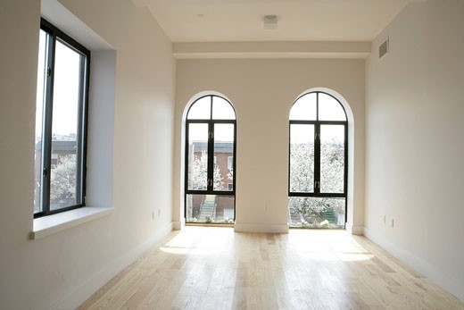 Stock Photo: 1742-10142 View of an unfurnished room, with arched windows