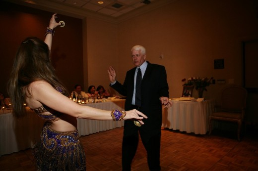 Stock Photo: 1742-11239 Senior man dancing with a belly dancer