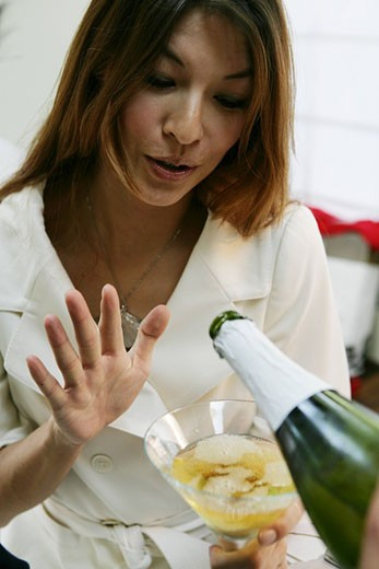 Woman watching a drink pour into her glass : Stock Photo