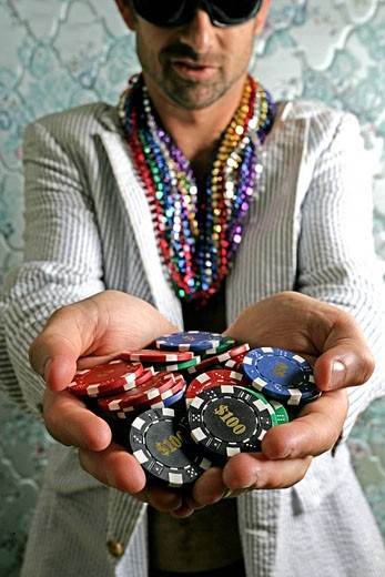 Stock Photo: 1742-11878 Close_up of a man holding poker chips in his hands