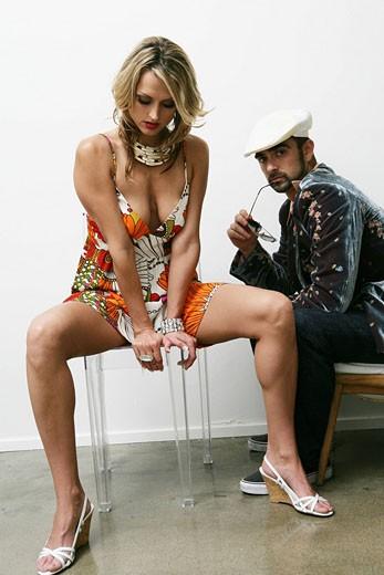 Stock Photo: 1742-12519 Young stylish couple sitting indoors
