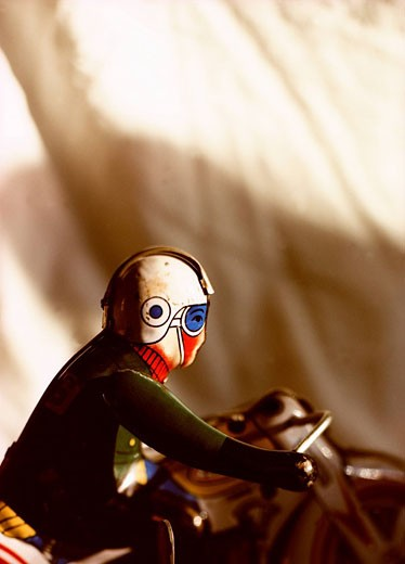 Stock Photo: 1742-13009 Minature man on motorcycle, close_up view.