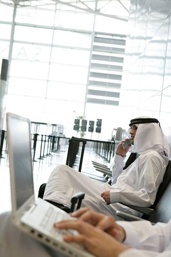 View of two Arab men waiting at airport. : Stock Photo