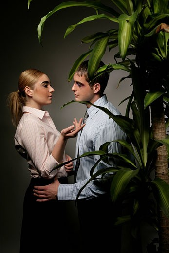 Stock Photo: 1742-9945 Young couple romancing, side view
