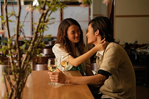 Stock Photo: 1742R-1270 Young couple, side view