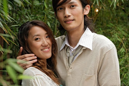 Stock Photo: 1742R-1285 Young couple embracing, close-up