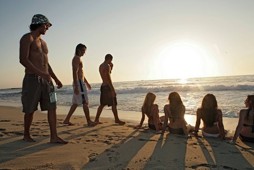 View of young people relaxing on a beach : Stock Photo