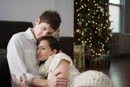 Stock Photo: 1742R-14603 Portrait of young affectionate couple relaxing at home on Christmas