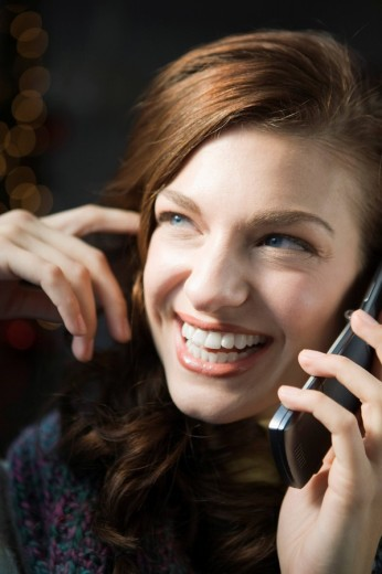 Stock Photo: 1742R-14935 Portrait of young happy woman on the phone