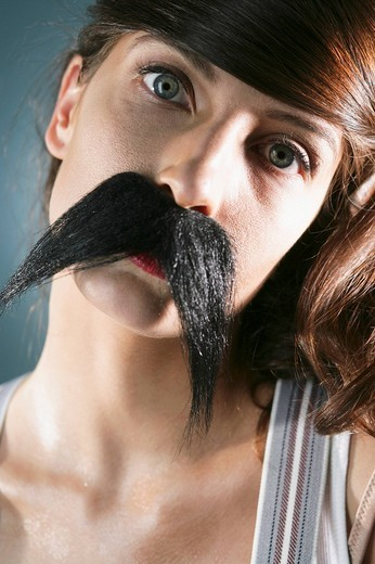 Stock Photo: 1742R-15652 Serious young woman disguised with fake moustache