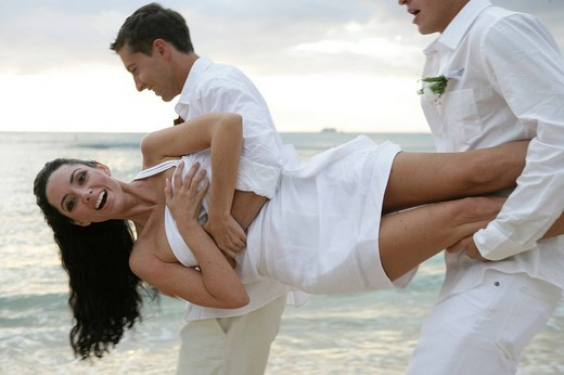 Stock Photo: 1742R-15913 Men carrying cheerful bride on beach