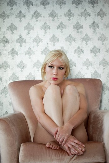 Stock Photo: 1742R-16562 Portrait of blonde woman at home in the nude