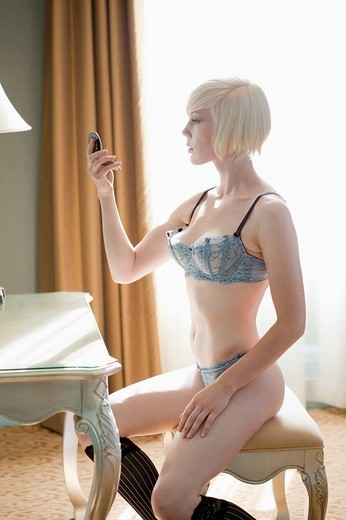 Stock Photo: 1742R-17357 Portrait of blonde woman at home in lingerie
