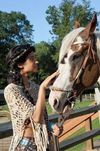 Woman with horse outside : Stock Photo