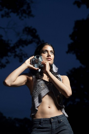 Stock Photo: 1742R-18221 Portrait of woman outside at twilight with camera