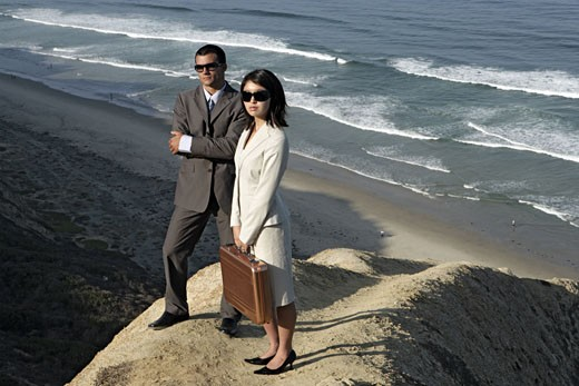 Stock Photo: 1742R-1839 View of a man and a woman standing on a cliff.