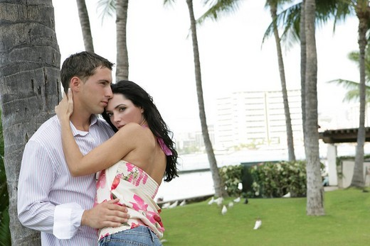 Young couple romancing outdoors : Stock Photo