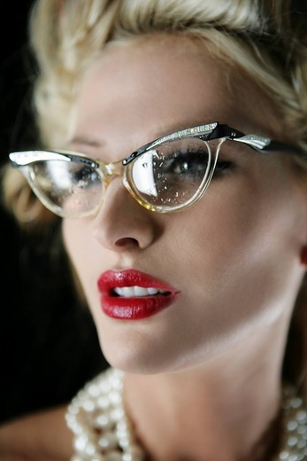 Portrait of sexy blonde woman in eyeglasses and pearl necklaces : Stock Photo