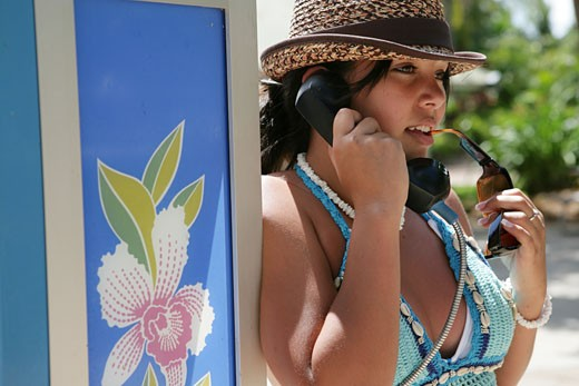 View of a woman talking on the phone. : Stock Photo