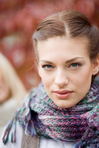 Portrait of young woman in scarf on autumn day : Stock Photo