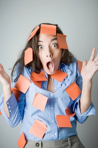 Portrait of a young woman covered with adhesive notes : Stock Photo