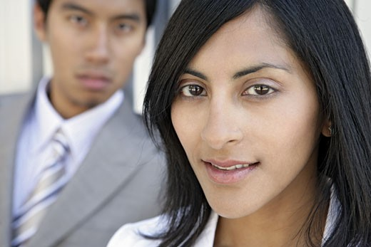Two executives looking at the camera. : Stock Photo