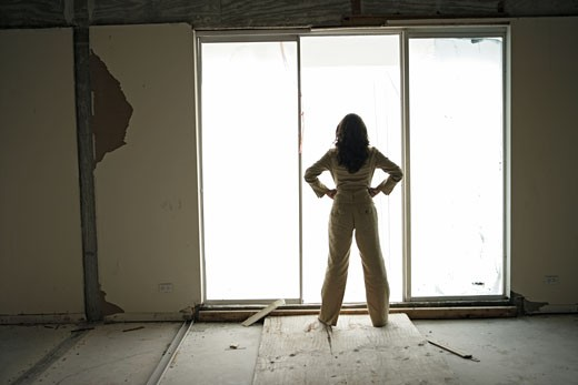 View of a businesswoman in an architectural building. : Stock Photo