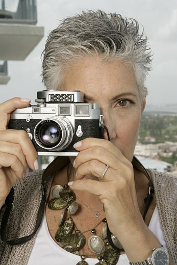 Mature woman taking a picture : Stock Photo