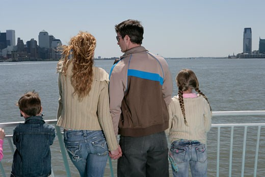 Stock Photo: 1742R-3115 Family of four sightseeing