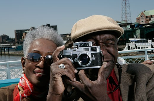 Mature couple with a classic camera : Stock Photo