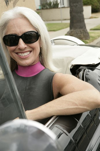 Portrait of a woman sitting in a car. : Stock Photo