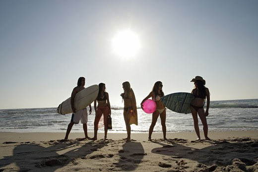 Stock Photo: 1742R-3257 View of five people on a beach.