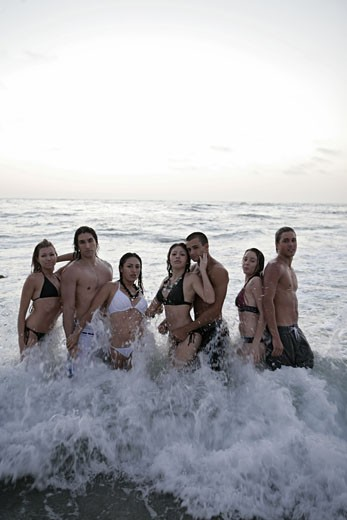 Stock Photo: 1742R-3277 View of young people posing on a beach.