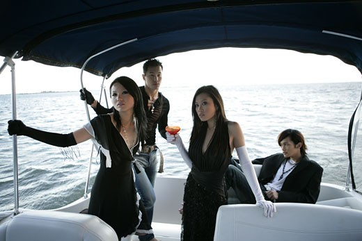 Stock Photo: 1742R-3870 View of two couples in a yacht.