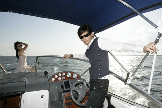 Stock Photo: 1742R-3892 View of a couple in a yacht.