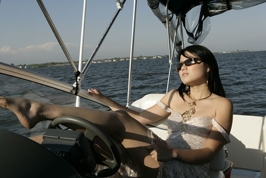 View of a young woman relaxing in a yacht. : Stock Photo