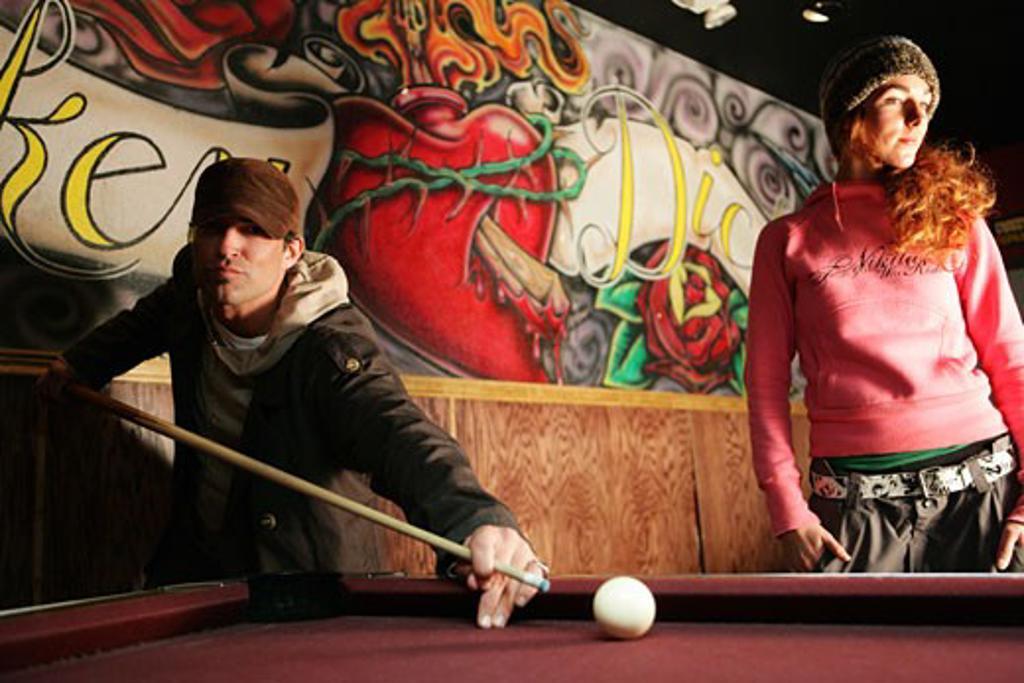 Man and woman playing pool : Stock Photo