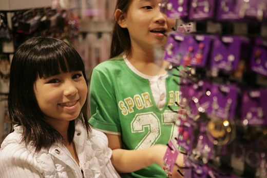 Two Asian girls shopping : Stock Photo