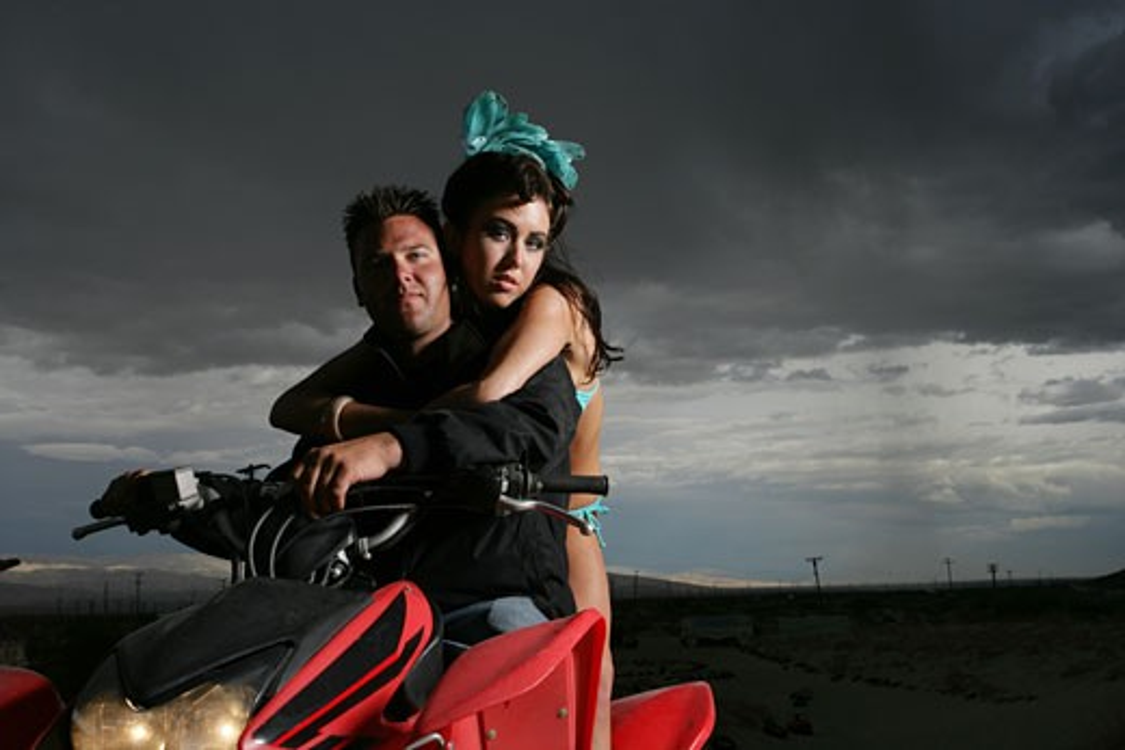 Stock Photo: 1742R-5426 Young couple riding ATV