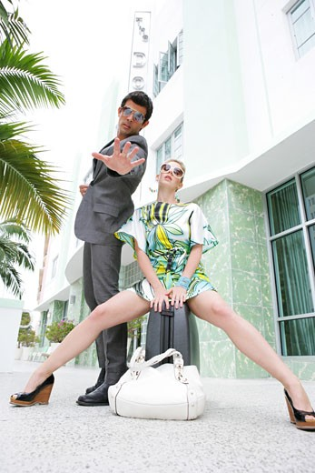 Fashionable couple waiting outside hotel. : Stock Photo
