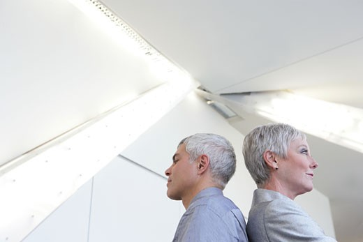 Stock Photo: 1742R-7624 Mature couple standing in airport.