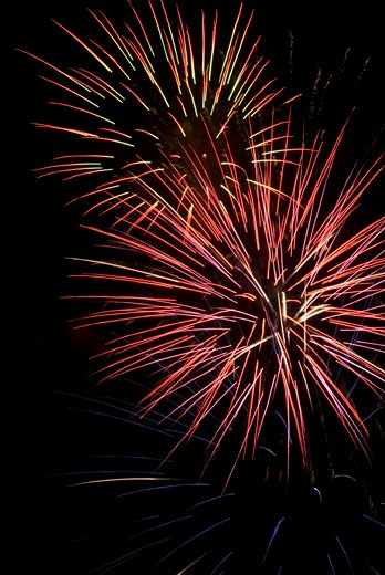 Low angle view of fireworks display at night : Stock Photo
