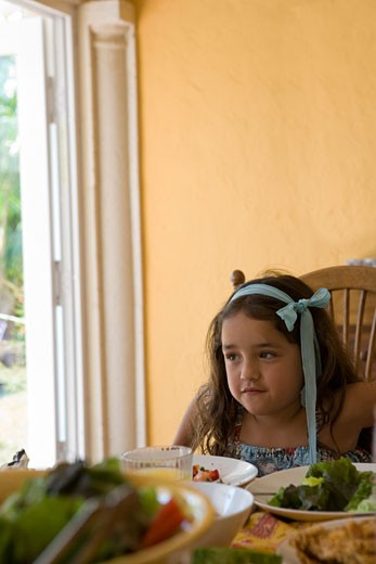 Stock Photo: 1745-115 Girl sitting at a dining table