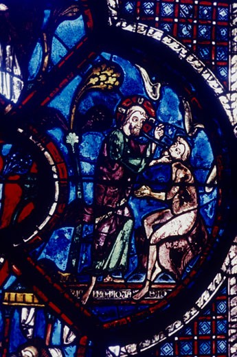 God creating Adam. Chatres Cathedral stained glass window of the Good Samaritan. 13th century : Stock Photo