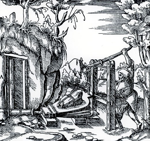 Ventilating a mine using bellows. From De re metallica, by Agricola, pseudonym of Georg Bauer (Basle, 1556).  Woodcut : Stock Photo