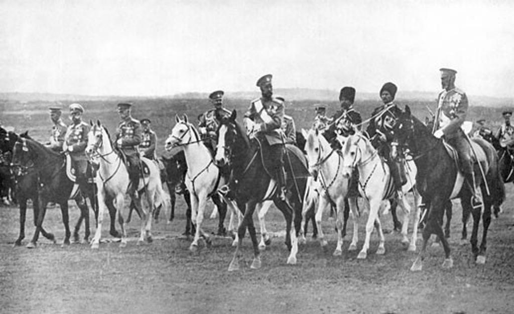 Nicholas II, (1868-1919), Tsar of Russia, on horseback accompanied by his staff officers : Stock Photo
