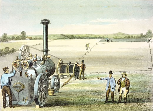 Stock Photo: 1746-2679 Portable steam engine by Garrett & Sons, Ipswich, being used with ploughing tackle to draw plough (r.background) back and forth across a field. Hand-coloured engraving c. 1860